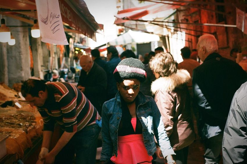 The Week On EyeEm Analogue Photography Market Men Retail  Real People Large Group Of People Lifestyles Adult Women Day Adults Only City Outdoors Only Men People Crowd Palermo Migrants Streetphotography Urban Shadows & Lights Street Photography Film Photography Press For Progress