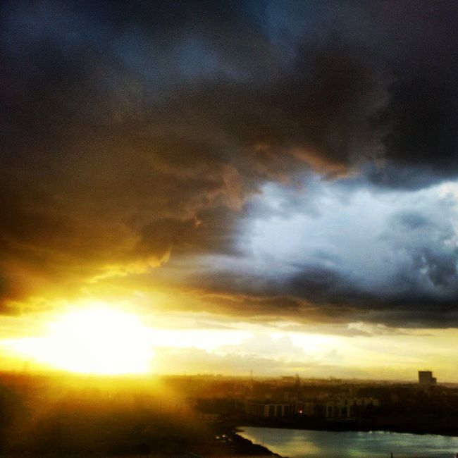 Instasunset Sunray Balconyview Stormiscoming DarknessIntoLight Blackclouds Icyclouds Cloudporn Thundering Lake Cloudshadows Reality Weather Bangalore Bangaloredays Instaclicked Instalove Likes4likes Followforlike Share RepostWhiz
