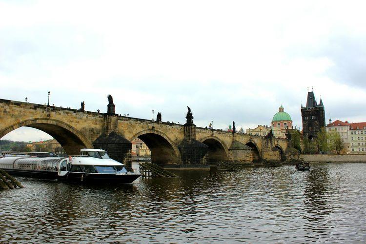 Ship⛴🌉under the Charles Bridge In Prague Bridge - Man Made Structure Architecture Arch Travel Destinations Reflection Built Structure Cloud - Sky Outdoors Water Day MyAdventure Czech Republic Moldau