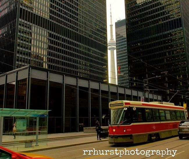 Peaking through. @outdoorphotomag @photographymagazine @PhotographyWeek Toronto Torontophoto Streetstyle Landmark Streetphotography Citylife Ontario Cntower LatourCN Ttc Ttcstreetcars Cabs Canada Tdcentre Kingstreetwest Transit Cityscapes Reflection Outdoorphotography Prophotographer Nikond7000 Nikonphotographers Nikonphotography Rrhurstphotography artsburlington latowphotographersguild