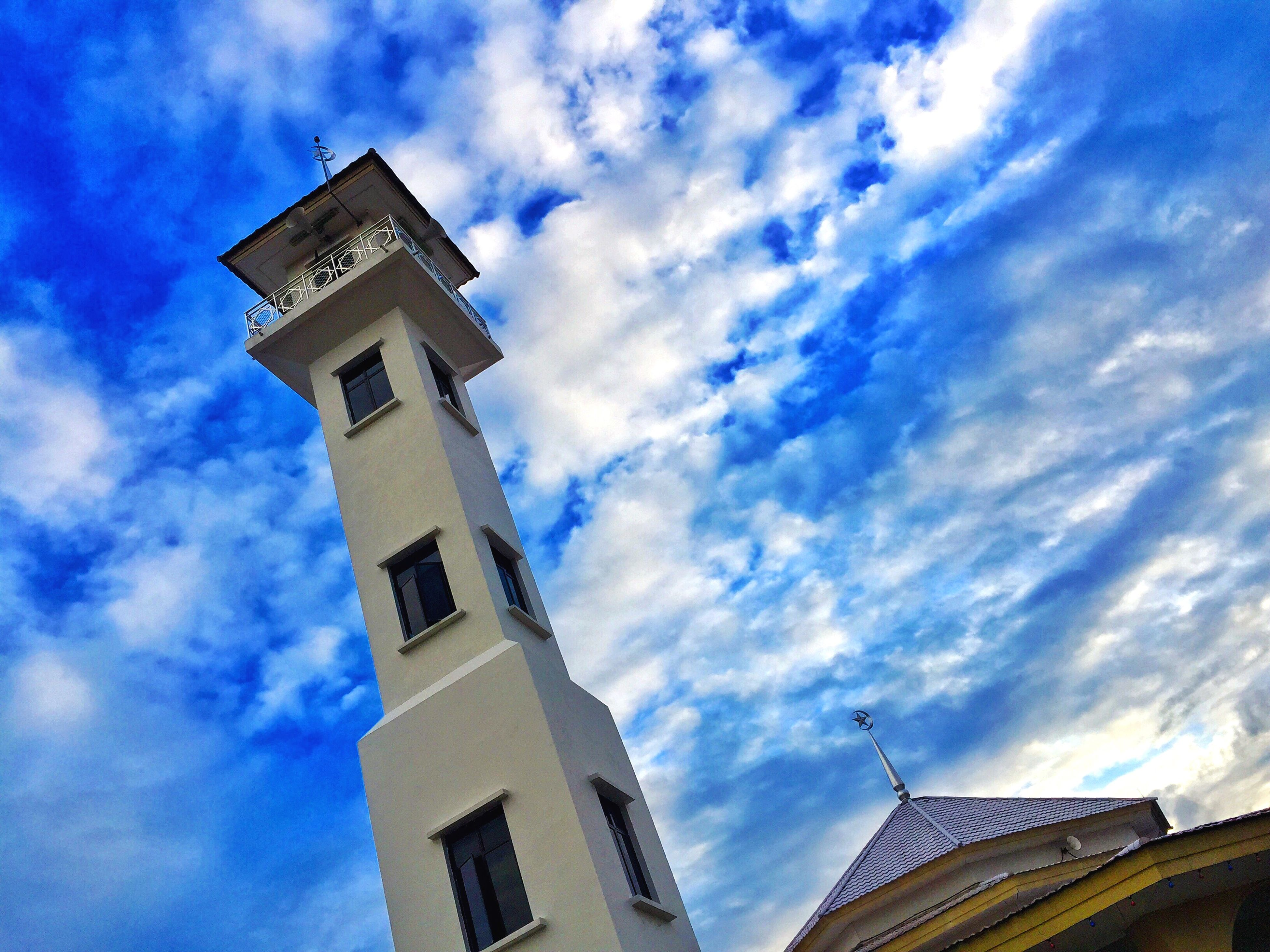 low angle view, architecture, sky, built structure, building exterior, cloud - sky, tower, blue, cloud, cloudy, tall - high, high section, outdoors, day, clock tower, no people, sunlight, tall, nature, building