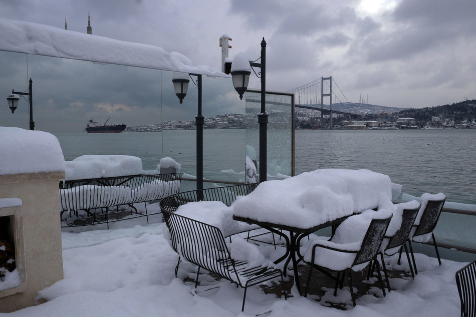 Snowed in outdoor restaurant at the Bosporus in Istanbul in winter time At The Bosporus Bosporus Bridge Cold Temperature Extreme Weather Frozen Istanbul Turkey Lots Of Snow Masses Of Snow No People Outdoor Restaurant Restaurant Snow Vessel On The Bosporus Water Winter Winter In Istanbul Winter Weather Winter Weather In Istanbul