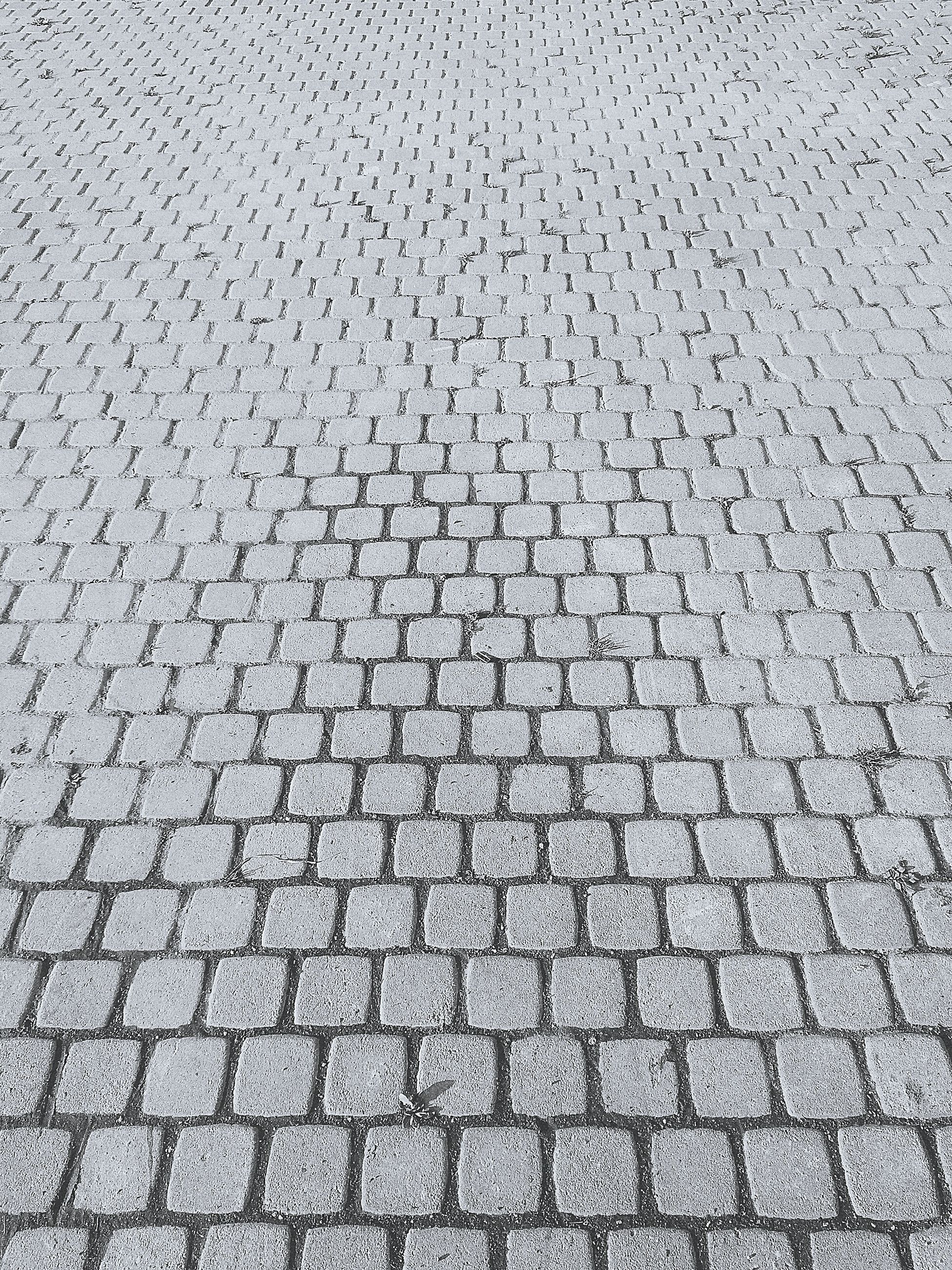 backgrounds, full frame, textured, detail, close-up, paving stone, pattern, cobblestone, concrete, footpath, repetition, day, stone material, outdoors, grey, stone tile, geometric shape, surface level, no people, pedestrian walkway, extreme close up, patterned