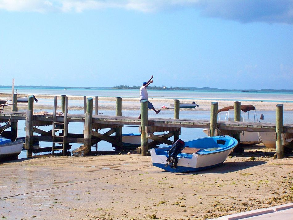 Animal Themes Beach Beauty In Nature Break The Mold Dancing Day Dock Horizon Over Water Jubilation Nature One Person Outdoors People Real People Sand Scenics Sea Sky Water Wharf