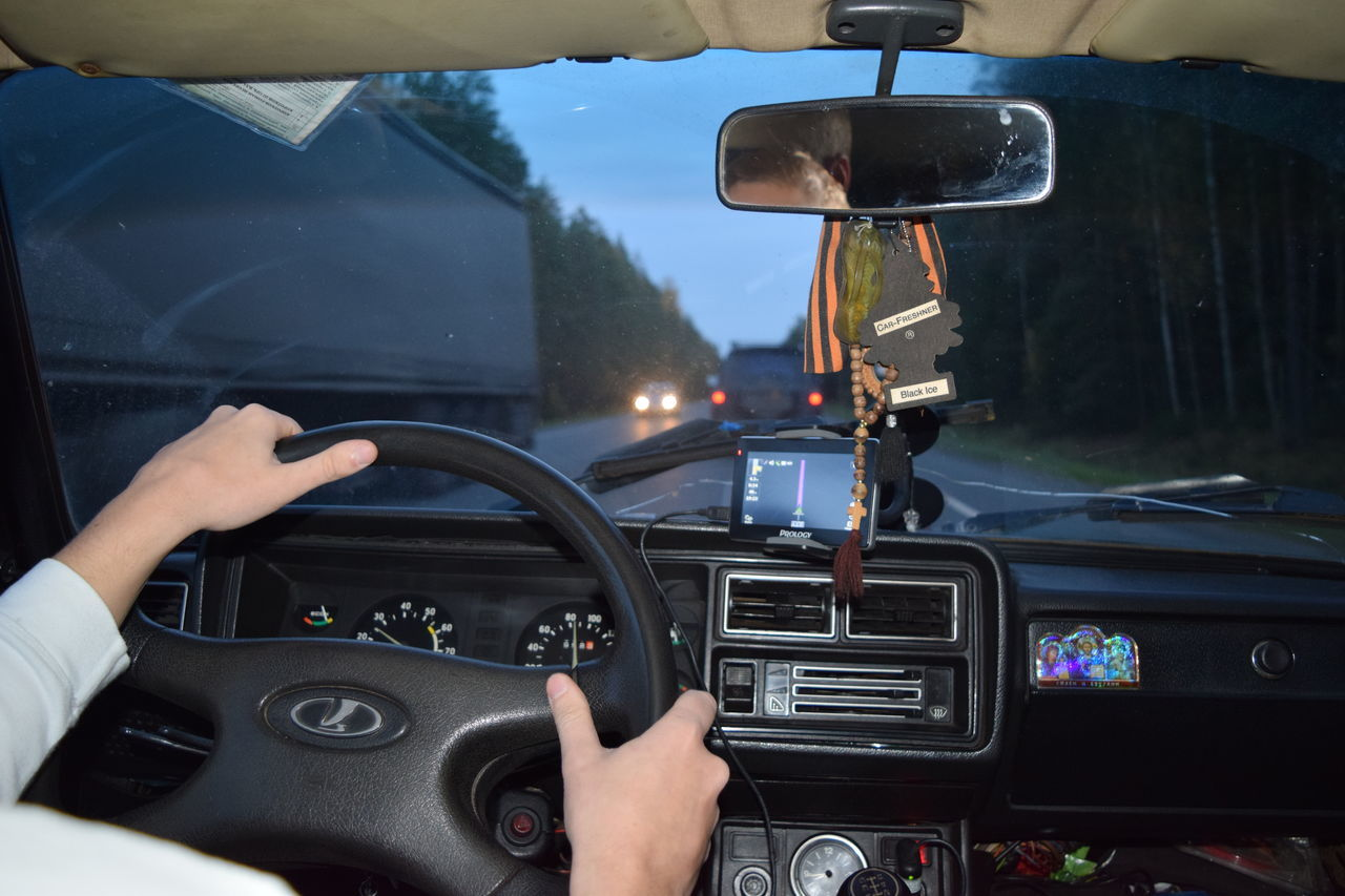 Car Car Interior Control Dashboard Drive Driving Driving Global Positioning System Human Body Part Human Hand Land Vehicle Meter - Instrument Of Measurement Mode Of Transport One Man Only One Person Only Men Portable Information Device Speedometer Steering Wheel Technology Transportation Vehicle Interior Windshield The Drive