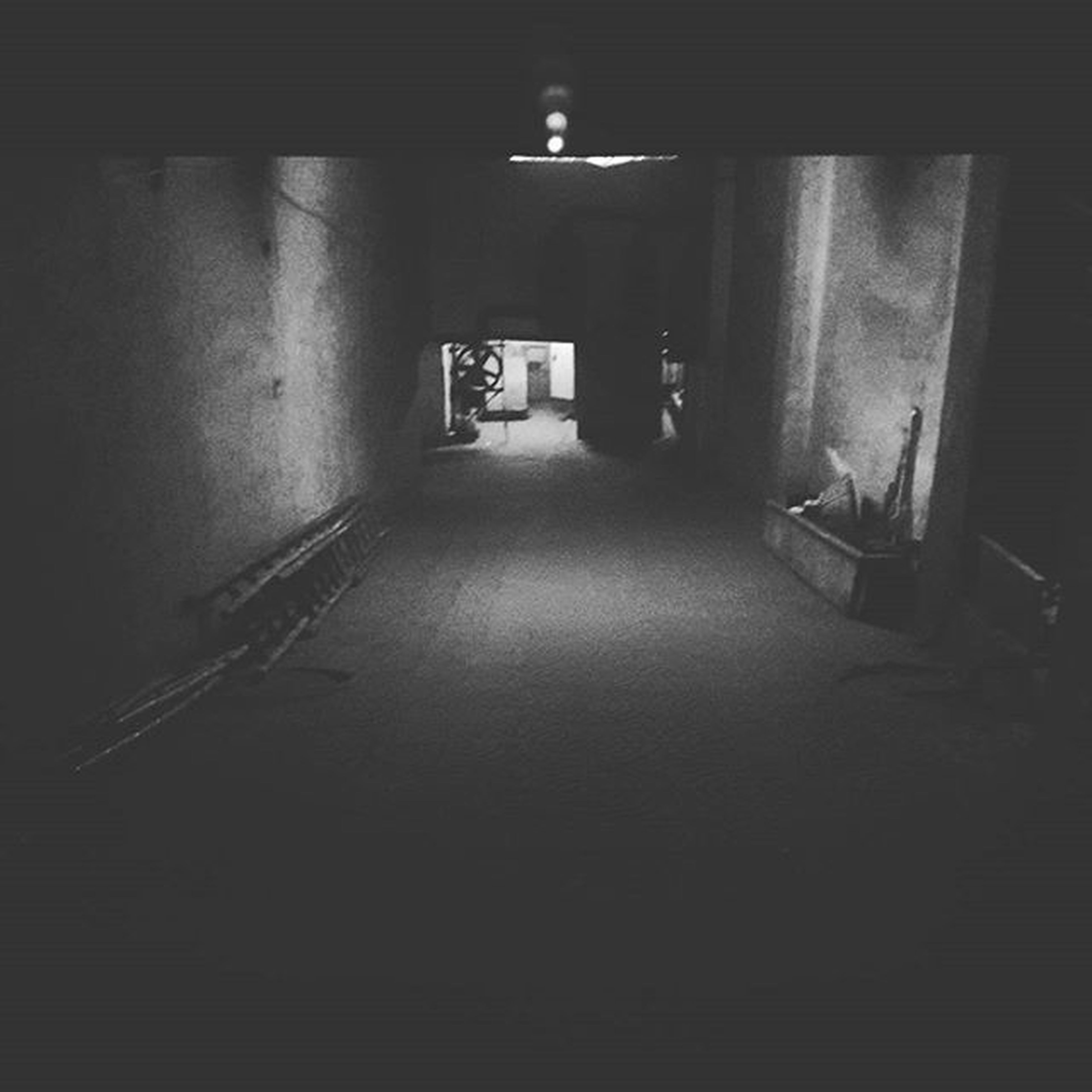 indoors, architecture, built structure, illuminated, the way forward, corridor, empty, absence, door, wall - building feature, narrow, lighting equipment, diminishing perspective, building, wall, interior, flooring, house, night, no people