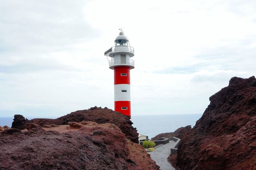 Lighthouse Tower Protection Safety Guidance Building Exterior Outdoors Built Structure Sky Sea Day No People Architecture Tenerife Tranquility Cloud - Sky Nature Landscape Water Scenics Beauty In Nature