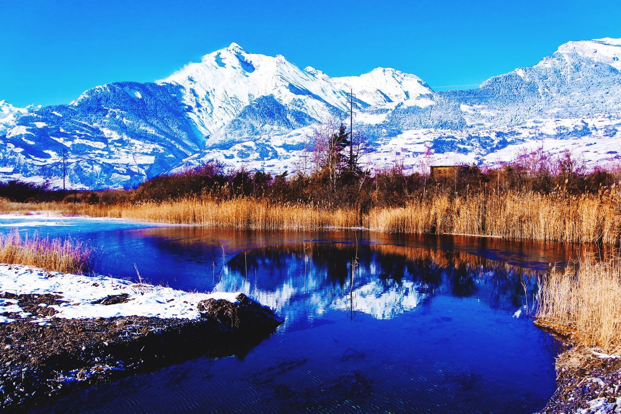 Beauty In Nature Tranquility Nature Reflection Tranquil Scene Water Snow Scenics Winter Lake Idyllic Blue Cold Temperature Non-urban Scene Mountain Tree Mountain Range Outdoors Landscape No People EyeEm Gallery EyeEm Nature Lover Eye4photography  Beauty In Nature Sky