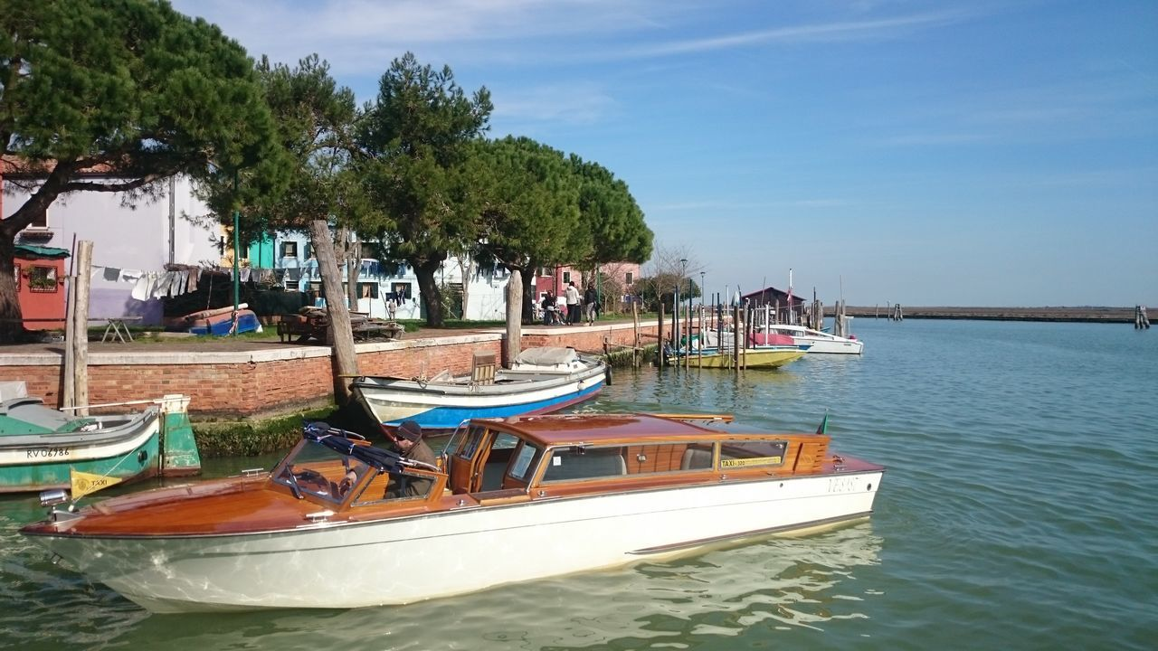 nautical vessel, transportation, water, moored, mode of transport, boat, tree, nature, waterfront, outdoors, day, sea, sky, no people, scenics, beauty in nature, longtail boat, jet boat