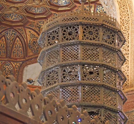 A beautiful Mamluk brass lantern in a corner of the complex of Sultan al-Mansur Qalawun in Cairo. Islam# Indoors  Lamp# Lantern# Metalwork# Mosque# No People Pattern