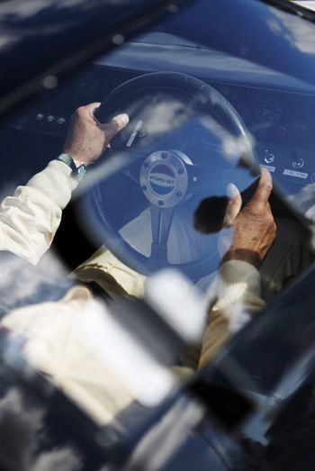 Hands on the wheel of a GT40 Lifestyles Leisure Activity Men Selective Focus Person Hobbies Person hands Arms gloves Racing Car Motorsport Ford GT 40 Racing Driver retro Classic Car Race Goodwood Revival Overalls Steering Wheel ready
