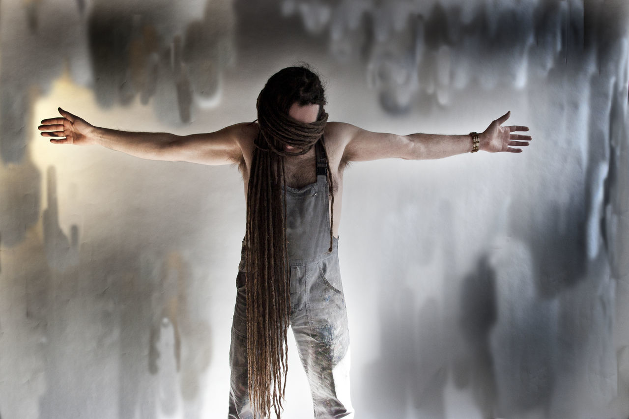 Arms Outstretched Day Full Length Hidden Eyes Indoors  Like Jezus Long Dreads Men Motion One Man Only One Person People Religious  Religious Art Standing Threatening Background Very Long Dreads Water White Man With Dreadlocks Young Adult