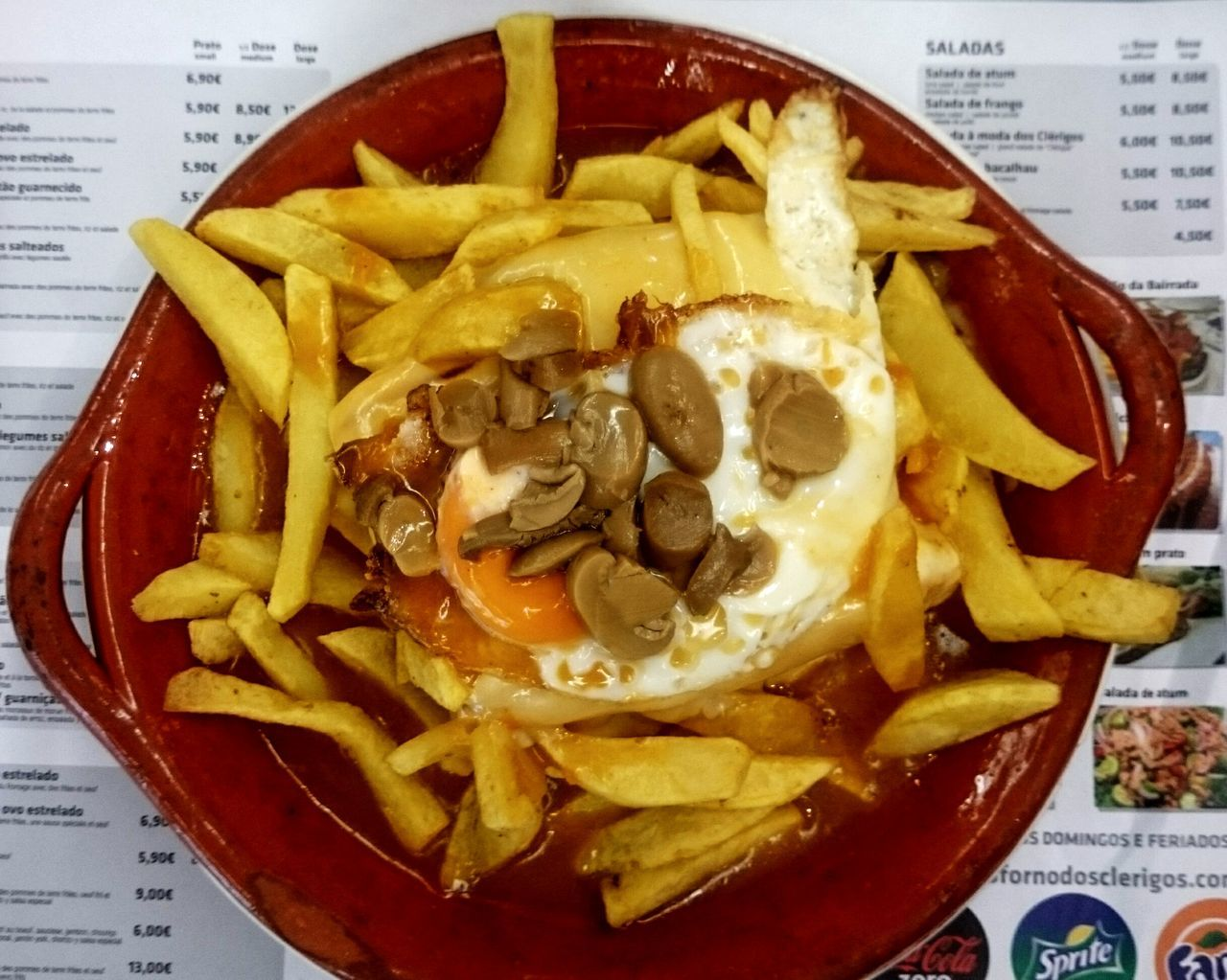 Another fine Porto tradition: franceshina. Layers of meat and cheese on toast. With an egg, chips and spicy sauce.