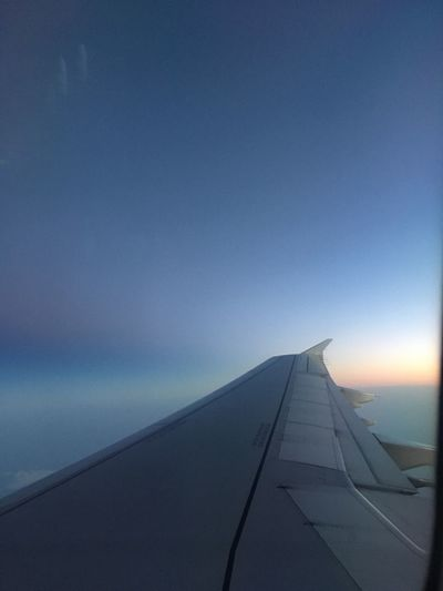 Airplane Transportation Journey Airplane Wing Travel Sky No People Air Vehicle Blue Mode Of Transport Aircraft Wing Nature Outdoors Flying Cloud - Sky Sunset Scenics Day Beauty In Nature Close-up