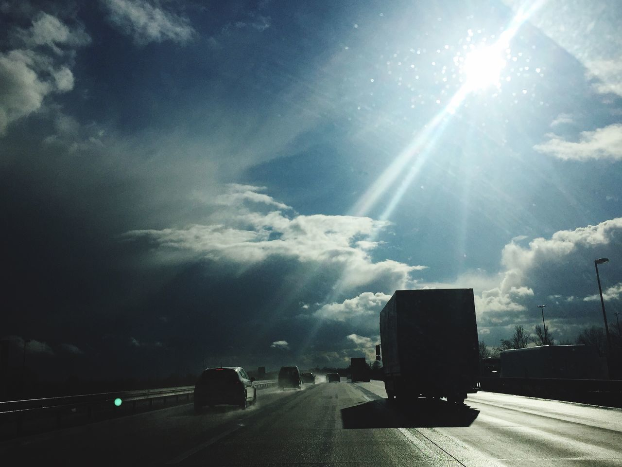 Sky Cloud - Sky Transportation Sunbeam Sunlight Lens Flare Sun Land Vehicle Nature Outdoors No People Autobahn Transportation Reflection Lkw Ontheroad Speed Shadow Speedway The Way Forward Clouds And Sky Cloudporn