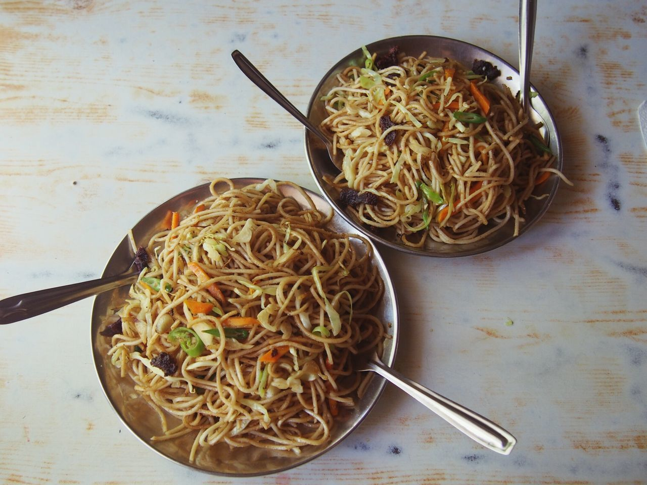 pasta, noodles, food and drink, spaghetti, freshness, fork, food, italian food, table, indoors, bowl, ready-to-eat, no people, healthy eating, chopsticks, serving size, high angle view, garnish, directly above, meal, plate, close-up, day