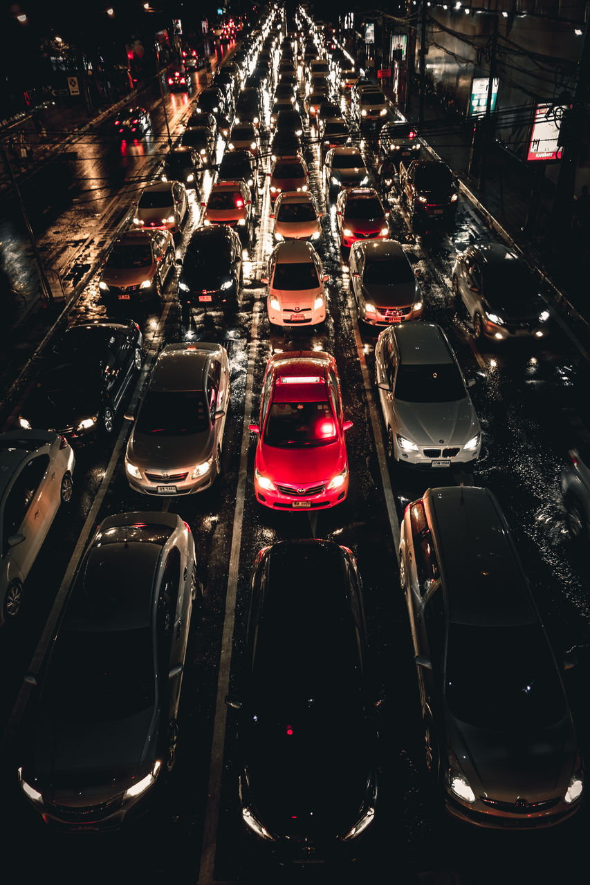in a row, car, red, high angle view, illuminated, indoors, no people, day, close-up