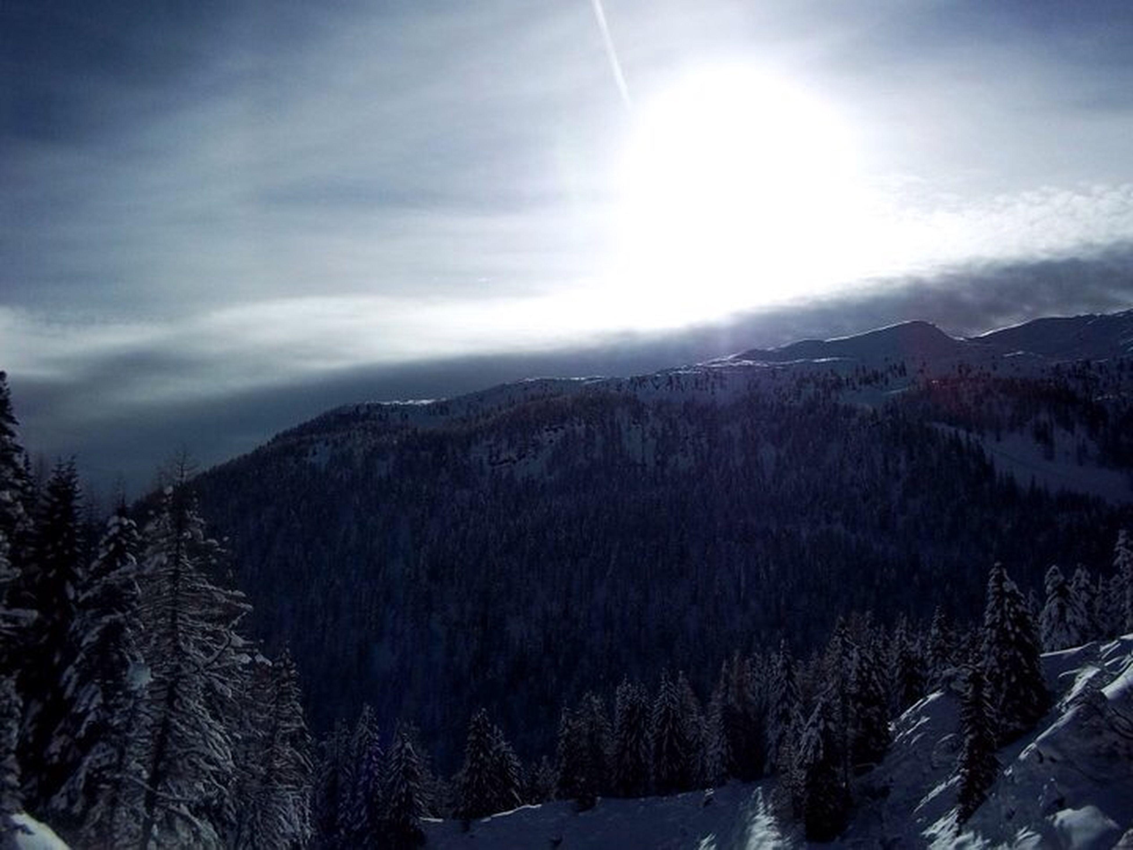 snow, mountain, winter, cold temperature, tranquil scene, tranquility, scenics, beauty in nature, mountain range, sky, season, sun, landscape, nature, sunlight, tree, snowcapped mountain, weather, sunbeam, cloud - sky