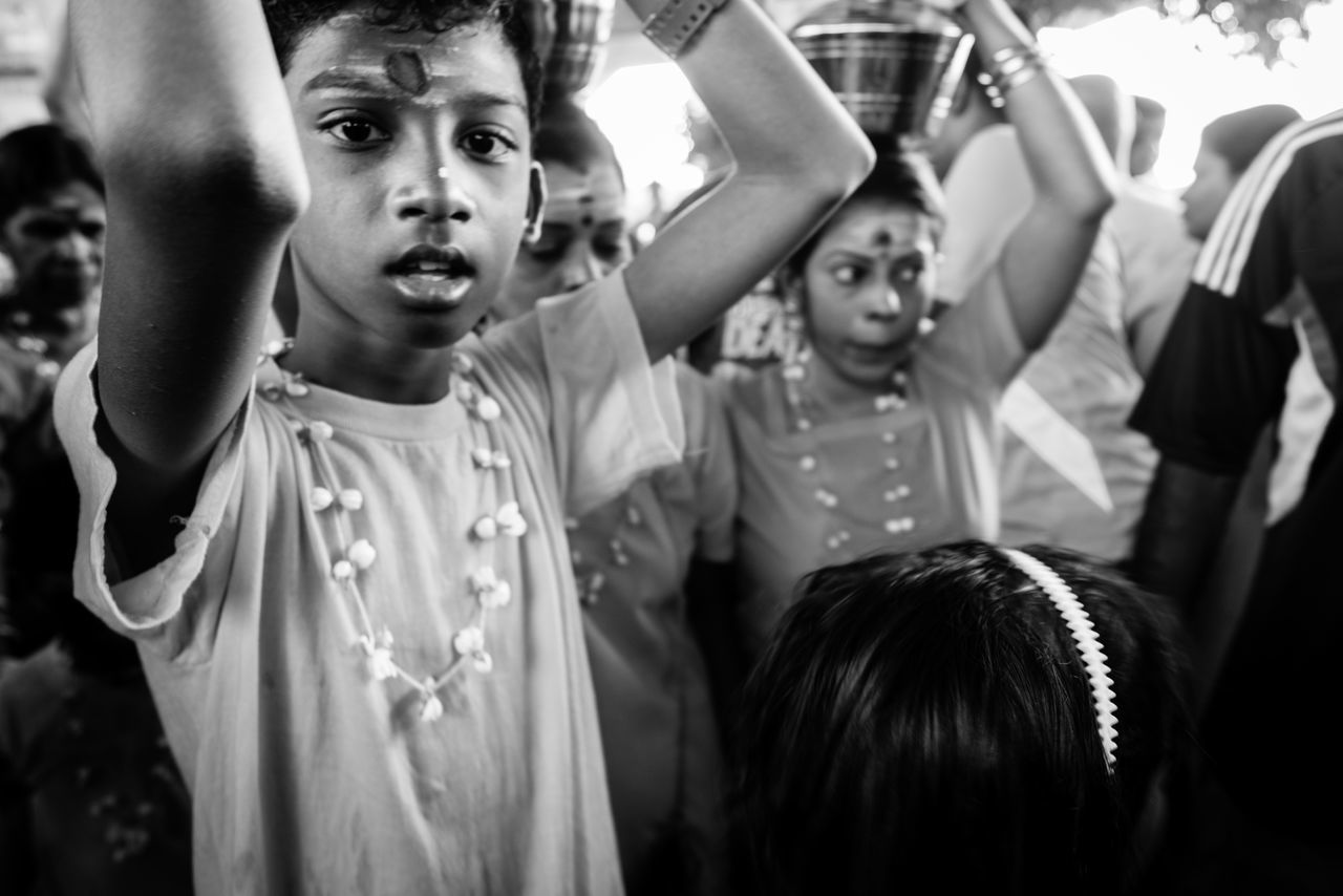 BATU CAVES, MALAYSIA - 9TH FEBRUARY 2017; Hindu devotees performing a pray session during Thaipusam festival in Batu Caves temple, celebrating Lord Murugan victory over the demon Soorapadman. Adult Adults Only Arms Raised Batu Caves -Malaysia Celebration Cheerful Cheering Close-up Competition Crowd Day Excitement Fan - Enthusiast Group Of People Hello World Hindu Temple Human Arm Human Body Part Outdoors People Real People Sports Event  Thaipusam 2017 Togetherness