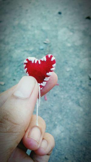 coração costurado à mão