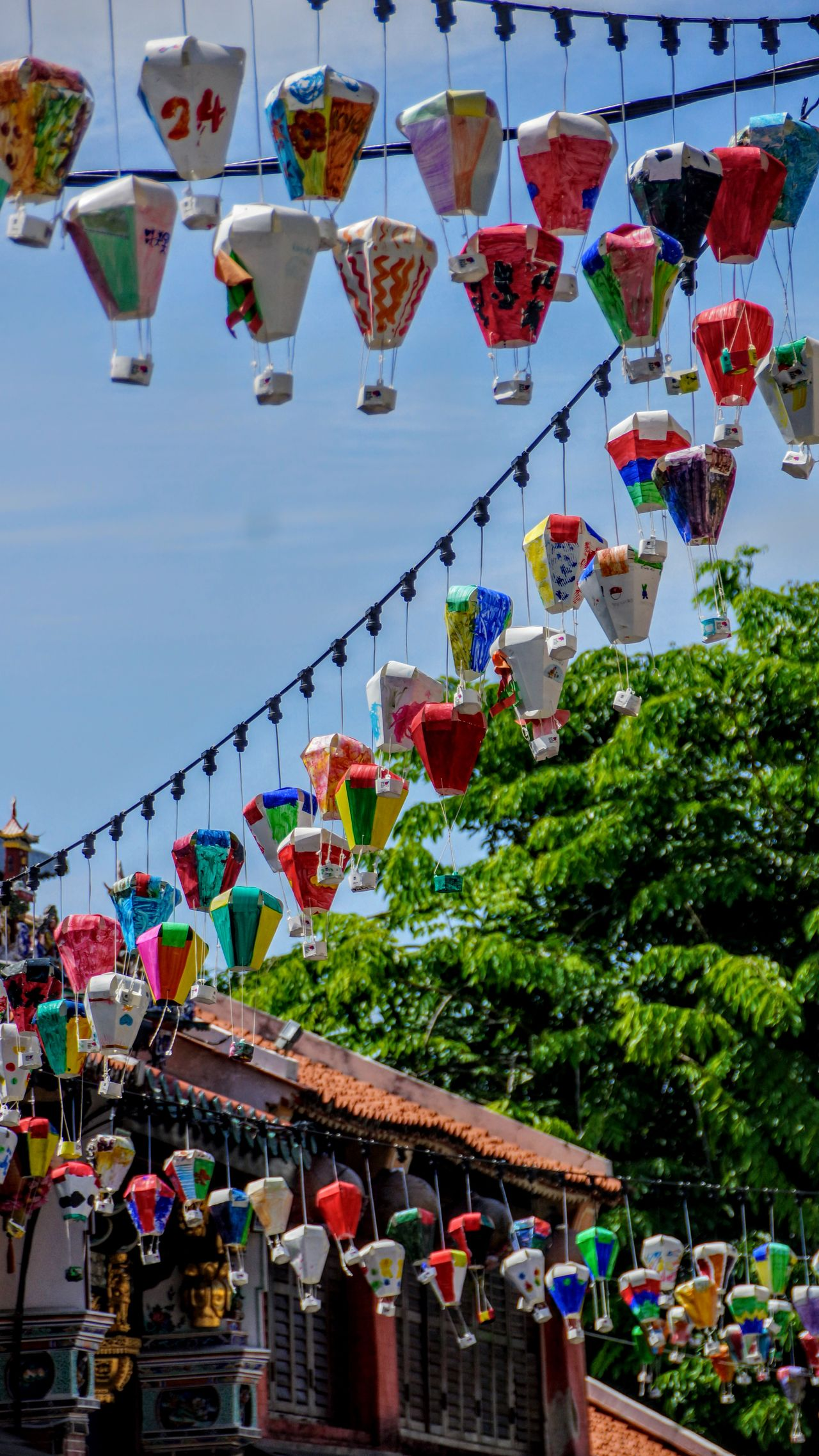 Colors path Asian Culture Georgetown Penang Tanglong UNESCO World Heritage Site World Heritage Architecture Building Exterior Built Structure Day Hanging Lantern Large Group Of People Malaysia Men Multi Colored Outdoors Pen People Real People Sky Street Streetphotography Tree Variation