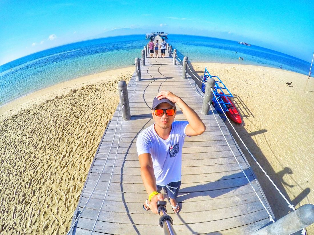 Beach Outdoors Vacations Riding Summer Sand Headwear Looking At Camera Sky Sea Day People One Person Alone, Thinking (...of You) Beaches, Vacation, Colour Vacation Time Enjoying The Sun Chillin Adult Shadow Sport Adults Only Fish-eye Lens Young Adult Portrait