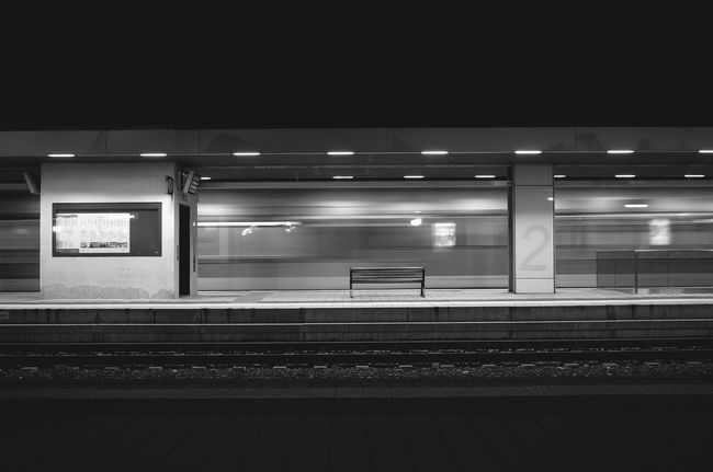 adieu Architecture Blurred Motion Capturing Motion Darkness And Light Empty Geometry Illuminated Monochrome Photography Need For Speed Night Nightphotography No People Rail Seat Speed Speeding Train Train Station Train Tracks Trainstation Urban Geometry