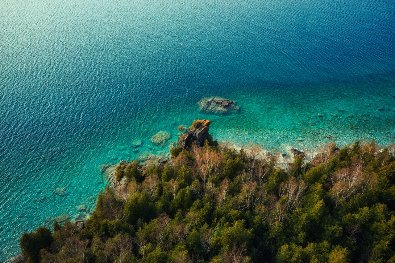 High angle view over pristine blue lake waters near Tobermory, Ontario Canada Beach Beauty In Nature Blue Blue Wave Crystal Clear Waters Day High Angle View Horizon Over Water Idyllic Nature No People Outdoors Plant Scenics Sea Tranquil Scene Tranquility Tree UnderSea Water First Eyeem Photo