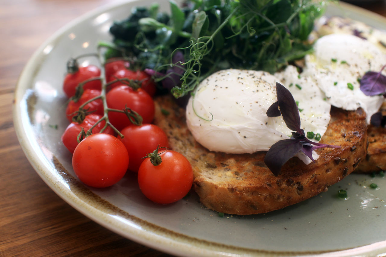 Poached eggs on toast Arugula Breakfast Brunch Cherry Tomatoes Close-up Eggs Benedict Eggs Florentine Food Food And Drink Freshness Healthy Eating Healthy Lifestyle Hipster Indoors  No People Poached Eggs  Ready-to-eat Ripe Tomatoes Salad Toast Tomatoes Tomatoes On The Vine Tomatoes On Vine Weekend