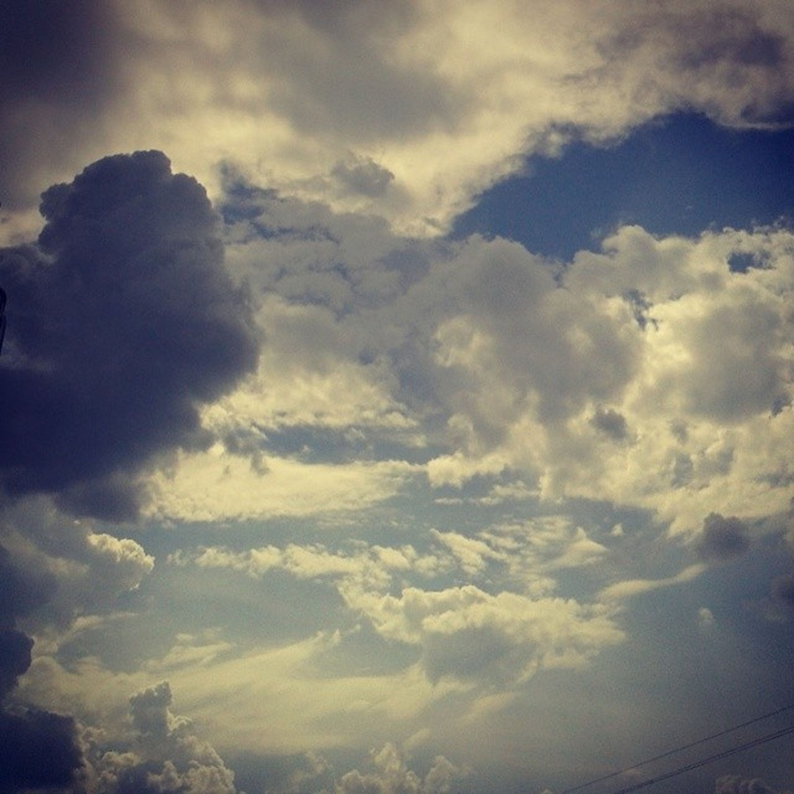 sky, cloud - sky, beauty in nature, tranquility, cloudy, scenics, low angle view, tranquil scene, nature, cloudscape, cloud, weather, idyllic, sky only, outdoors, silhouette, no people, overcast, majestic, blue