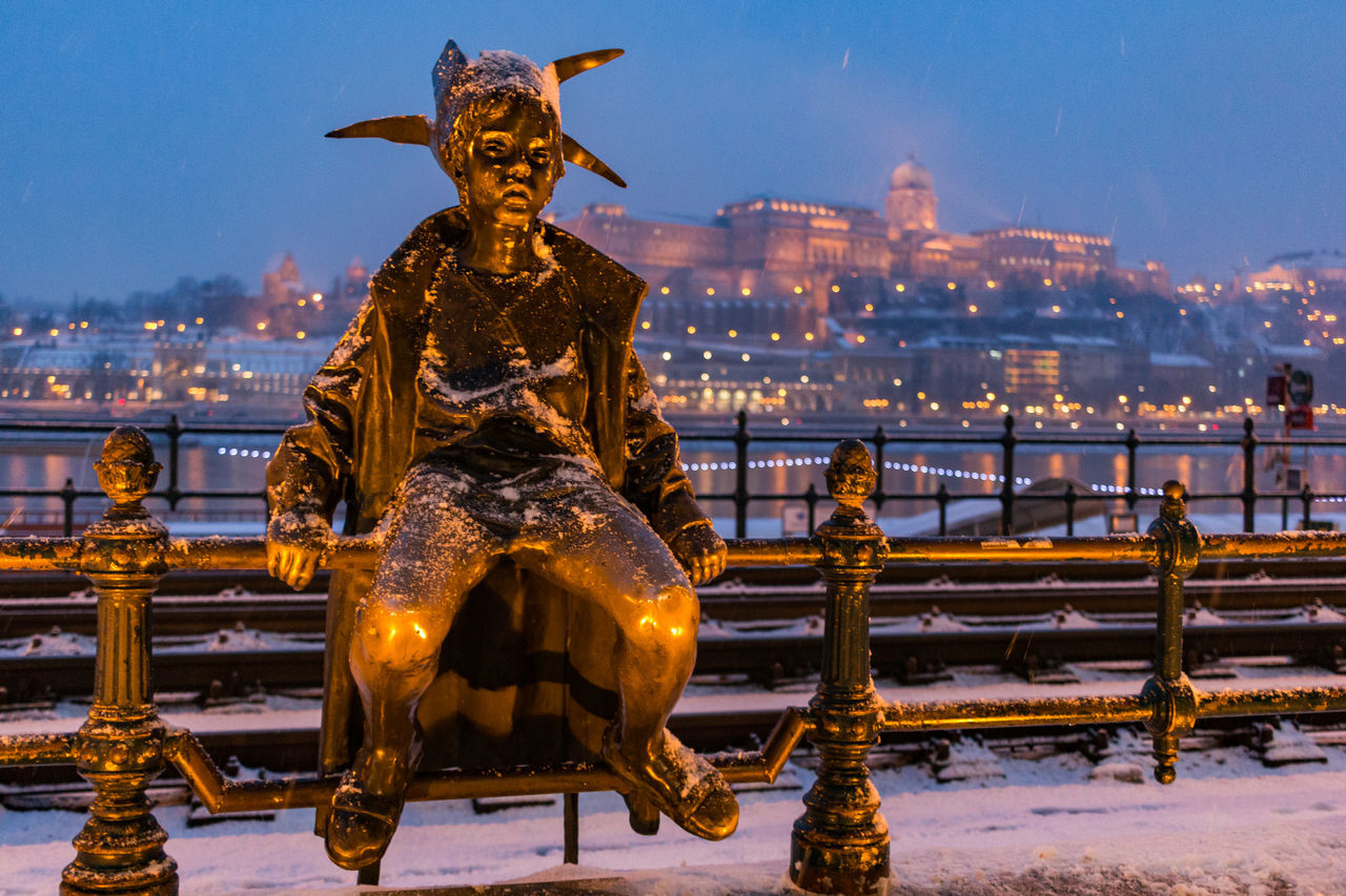 The Little Princess with the Royal Palace in the background. Art Budapest Hungary International Landmark It's Cold Outside Night Princess Railing Snow Statue Twilight Winter