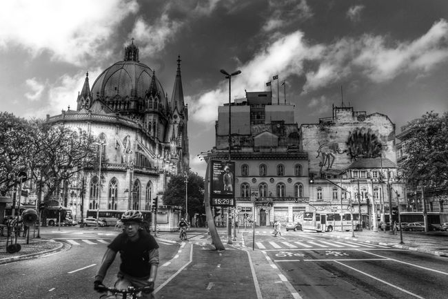 Monochrome Photography Architecture Built Structure Building Exterior Transportation Mode Of Transport Praça Da Sé São Paulo Brazil Dramatic Angles Famous Place My Veiw My City Black And White Photography Undergroundphotography Dramatic Black And White Blackandwhitephotography Fantastic View City Life Low Angle View Tranquil Scene Architecture Cathedral Travel Destinations Street City Outdoors