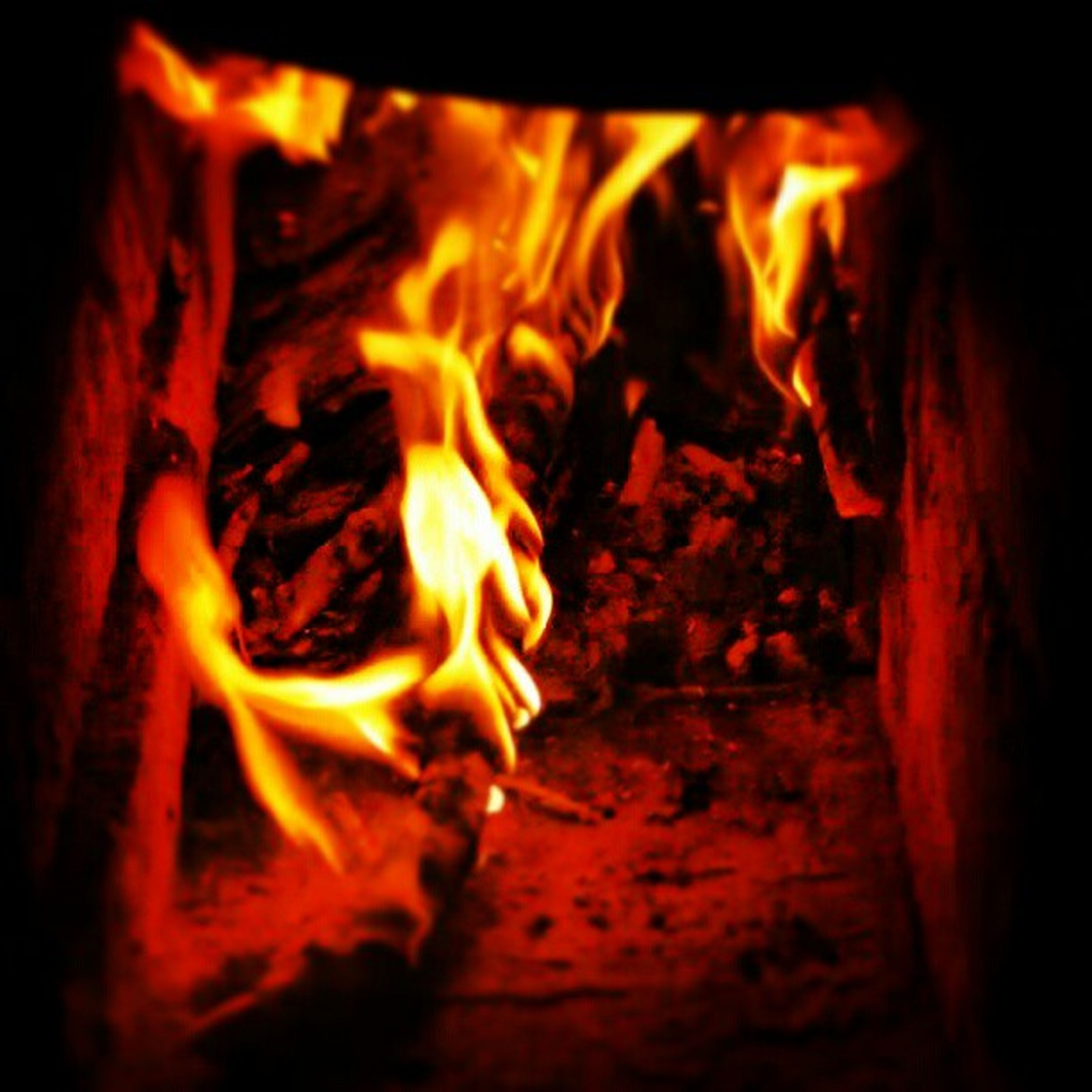 burning, flame, heat - temperature, fire - natural phenomenon, glowing, firewood, bonfire, fire, wood - material, orange color, close-up, night, indoors, heat, campfire, motion, dark, wood, light - natural phenomenon, no people