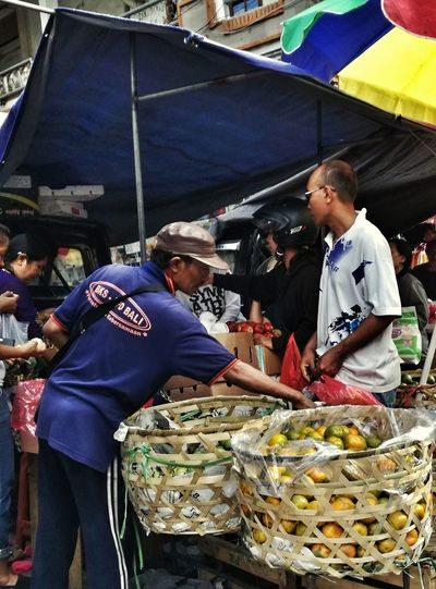 Market Stall Retail  Selling Market Business Finance And Industry For Sale Small Business Choice Adults Only People Occupation Adult Men Store Business Customer  Real People Day Only Men Sukawati Food Food And Drink Large Group Of Objects Choosing Fleamarket