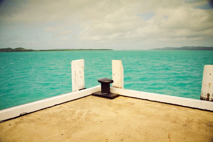 Thursday Island WeatherPro: Your Perfect Weather Shot Sea And Sky Dock Of The Bay Tropical Climate Dusty Stillness In Time Sea View Sea Simple Moment Simple Things Sitting On The Dock Of The Bay Travel No People Tropical Paradise Landscapes With WhiteWall My Eyes My Nature