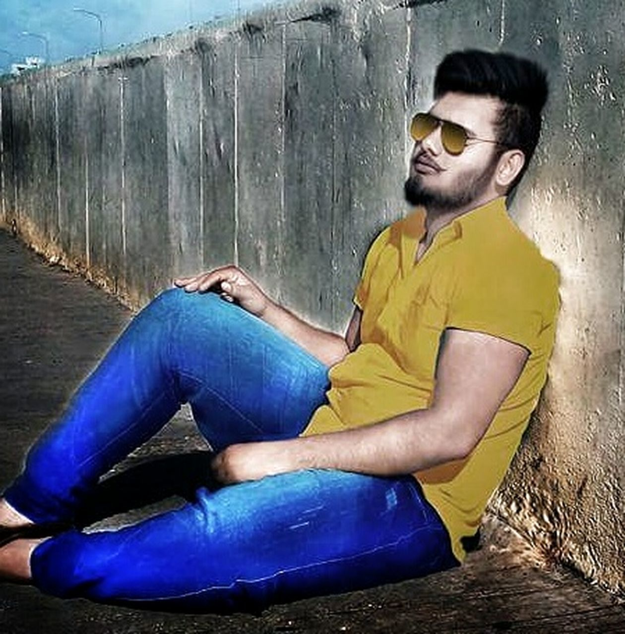 one man only, only men, adult, casual clothing, sitting, beard, adults only, full length, people, men, young adult, one person, human body part, one young man only, relaxation, outdoors, young men, eyeglasses, males, day, wireless technology