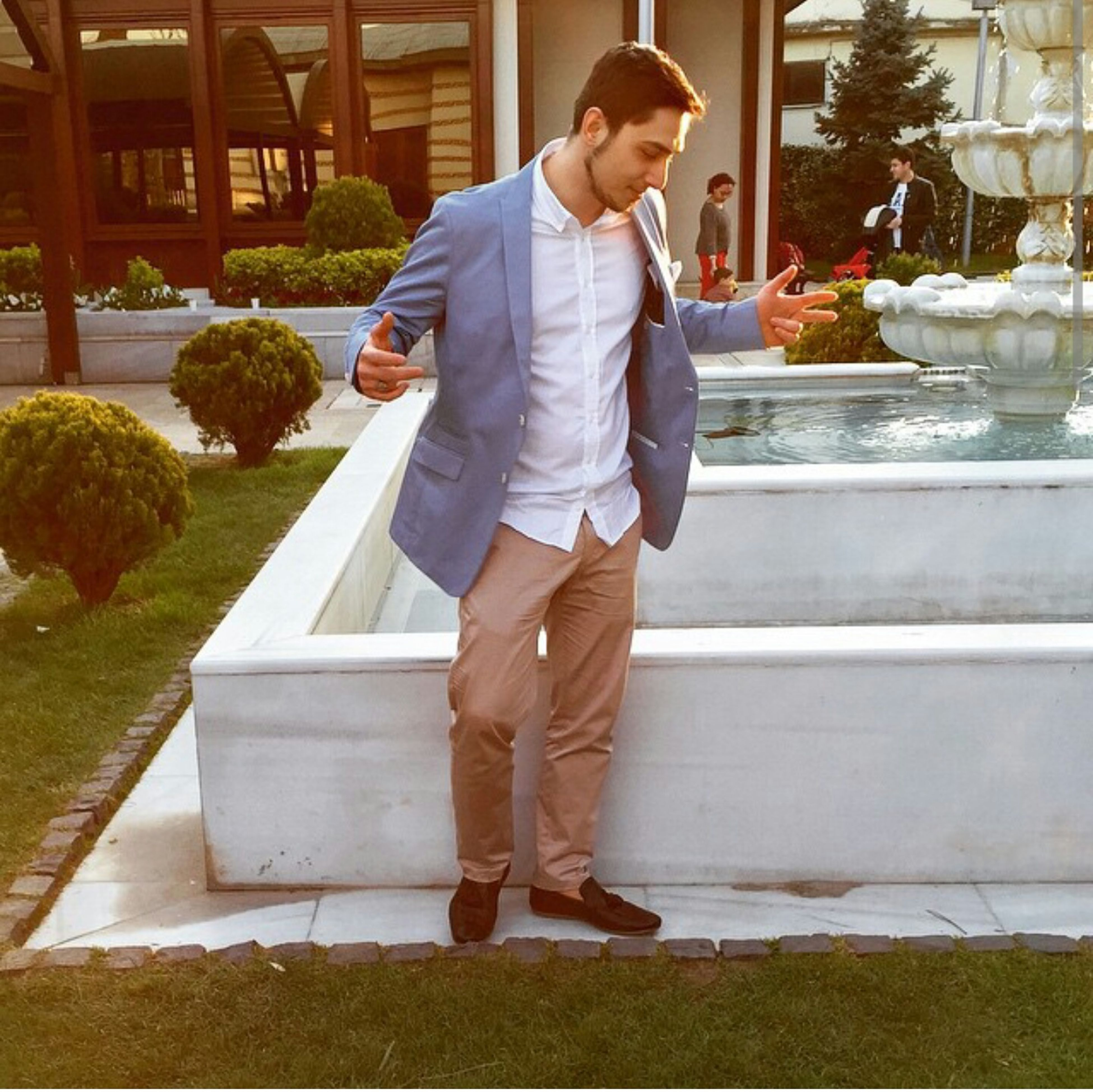 casual clothing, full length, standing, lifestyles, person, front view, built structure, architecture, leisure activity, building exterior, holding, three quarter length, young adult, window, childhood, front or back yard, elementary age, young men