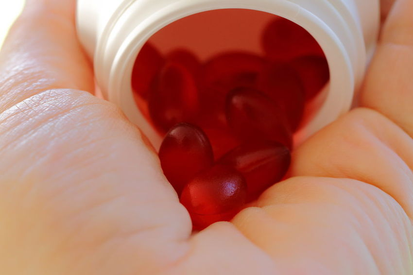 Red soft capsules on hand. Abundance Capsules Copy Space Doping Drugs Enhancement The Color Of Business EyeEm Best Shots The Color Of Sport Full Frame Hand Health Supplement Holding Illness Lifestyles Medication Person Personal Perspective Pivotal Ideas Red Remedy Sickness Soft Capsule Still Life White
