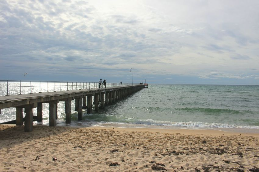 Beach Sea Water Pier Sand Shore Horizon Over Water Scenics Tranquil Scene Tranquility Sky Beauty In Nature Nature Idyllic Wave Cloud - Sky Jetty Cloud Outdoors Day