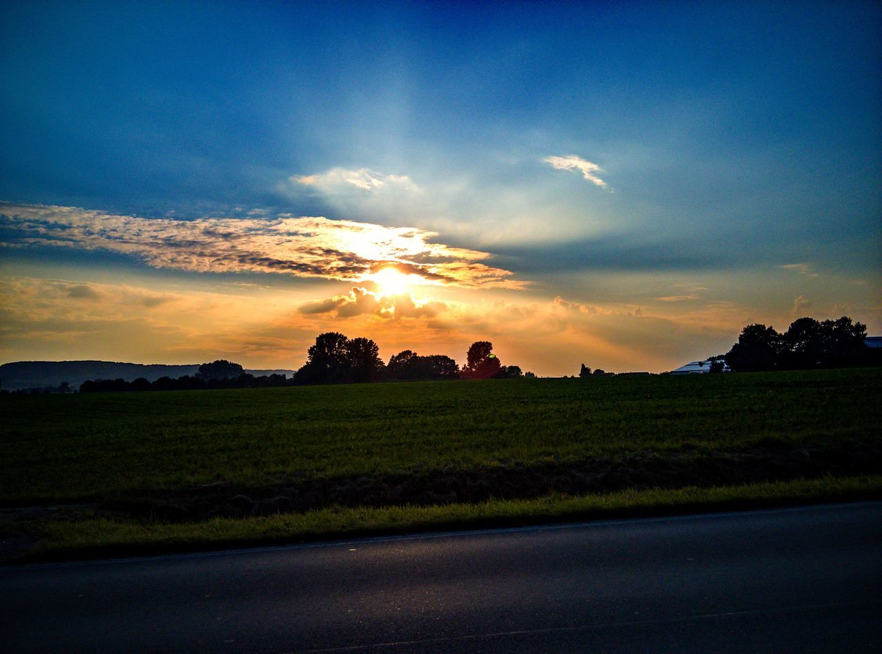 sunset, sky, nature, beauty in nature, tranquil scene, landscape, scenics, tranquility, cloud - sky, field, no people, grass, sun, outdoors, tree, rural scene, day