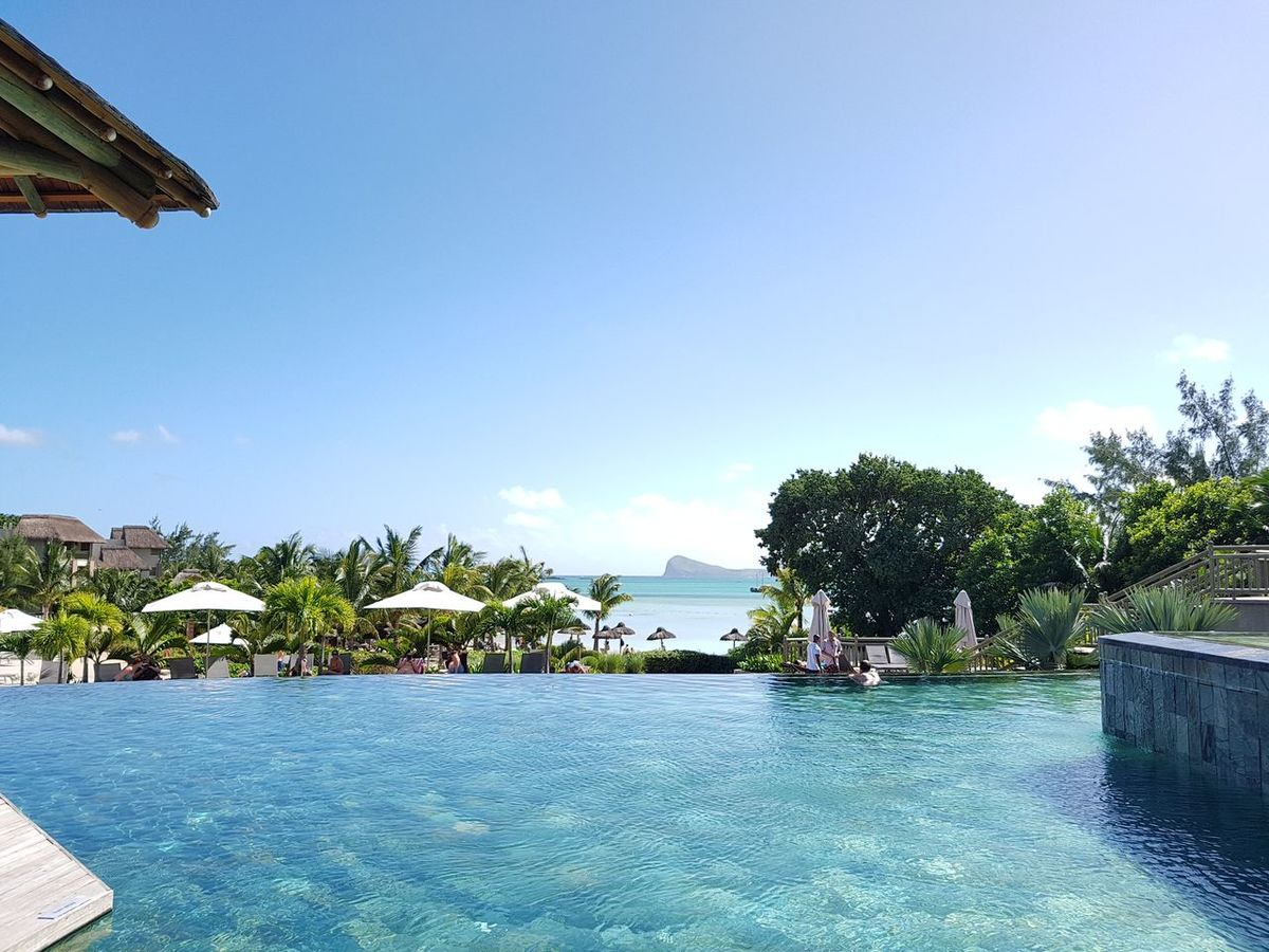 Sea Water Tourist Resort Vacations Tropical Climate Swimming Pool Blue Hotel Idyllic Luxury Travel Destinations Travel Luxury Hotel Tranquility Beach Architecture Palm Tree Tree Sky Scenics