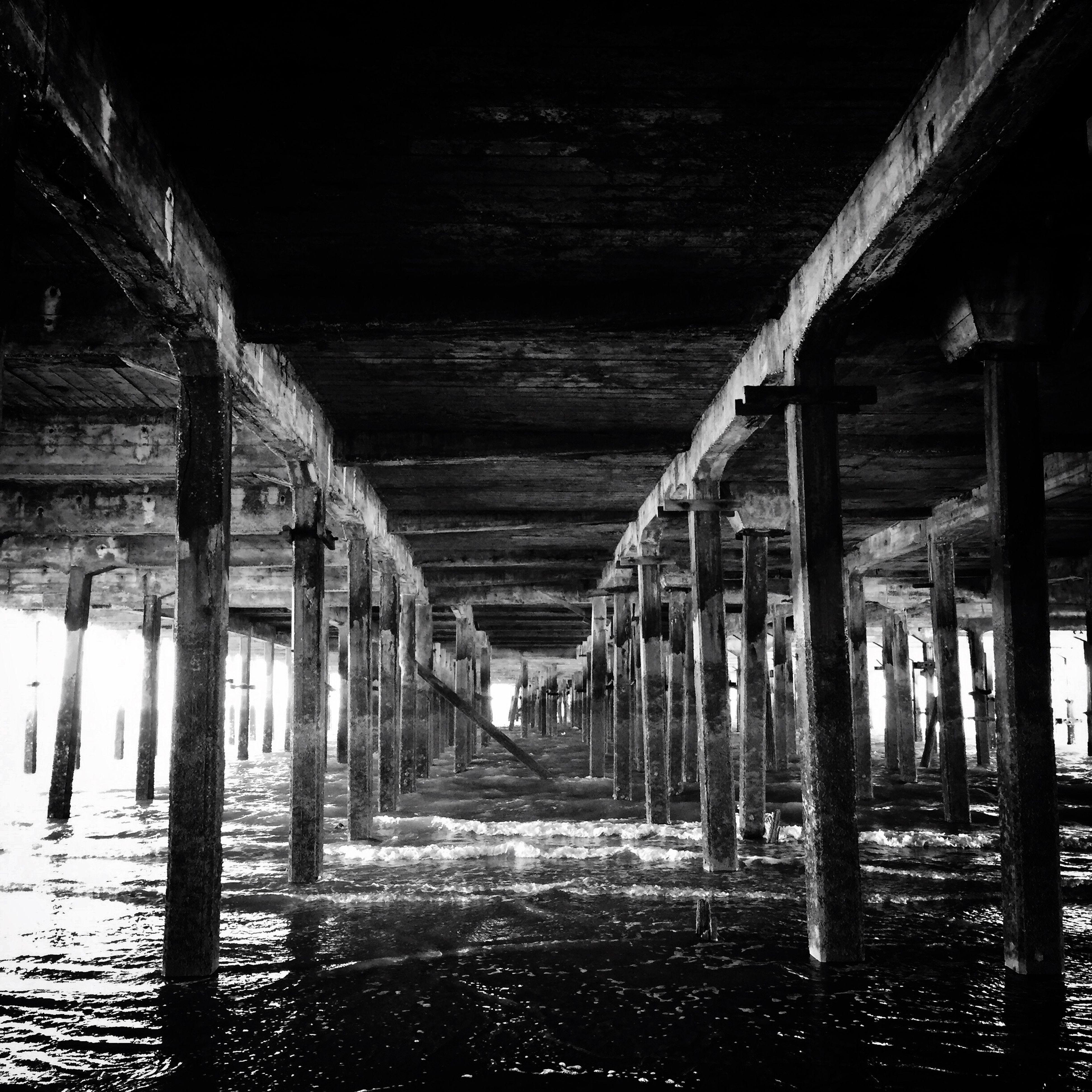Under the pier. Below Built Structure Column Pillar Water Weathered Where I Grew Up Essex Walton Pier Walton On The Naze Pier Blackandwhite