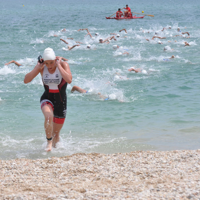 triathlon competition Adult Adults Only Adventure Athlete Beach Competition Day Exercising Full Length Motion One Young Woman Only Only Women Outdoors People Running Speed Sport Swimming Triathlete TRIATHLON Water Water Reflections Women Young Adult Young Women