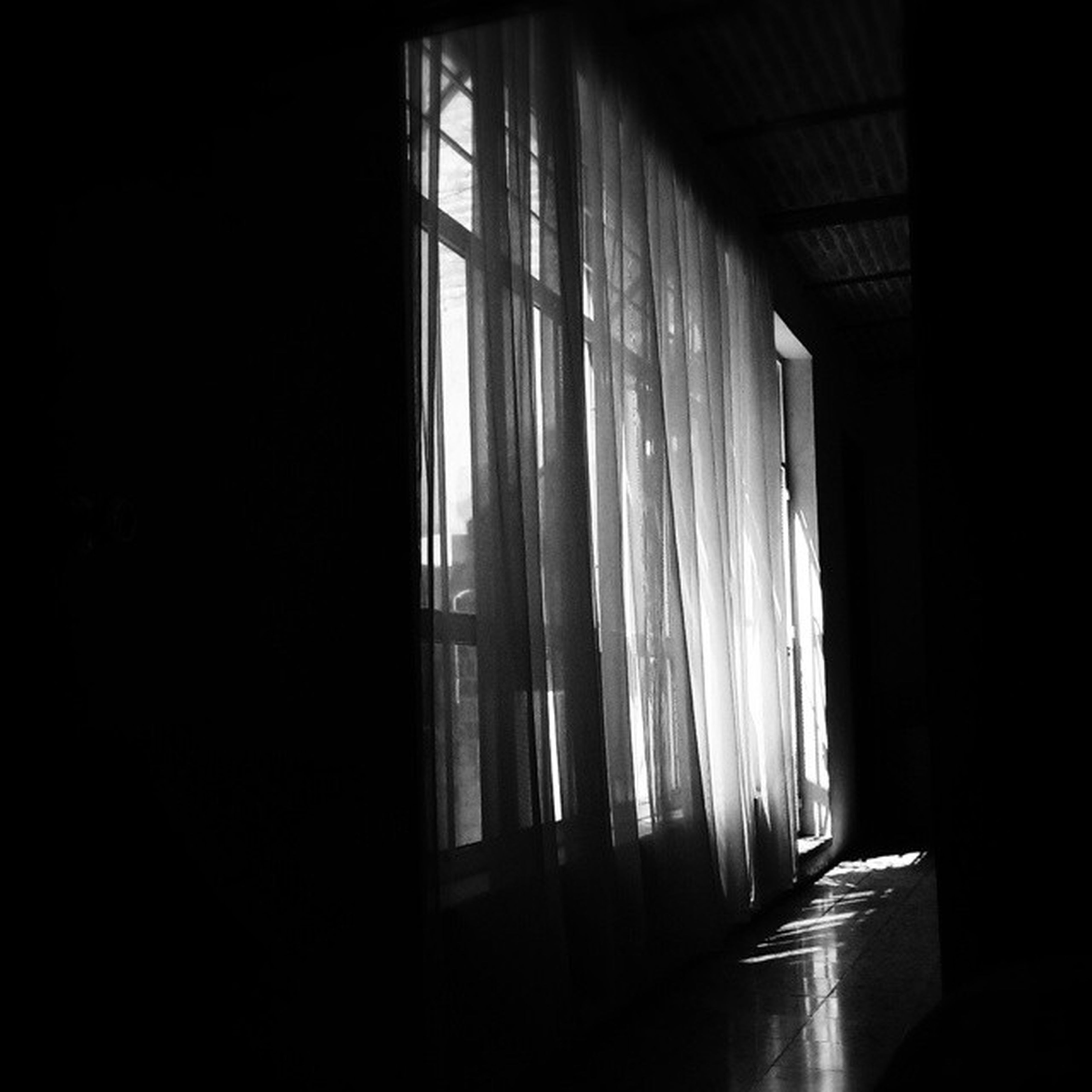 indoors, window, home interior, built structure, curtain, architecture, dark, sunlight, empty, absence, corridor, wall - building feature, house, wall, no people, shadow, flooring, glass - material, interior, door