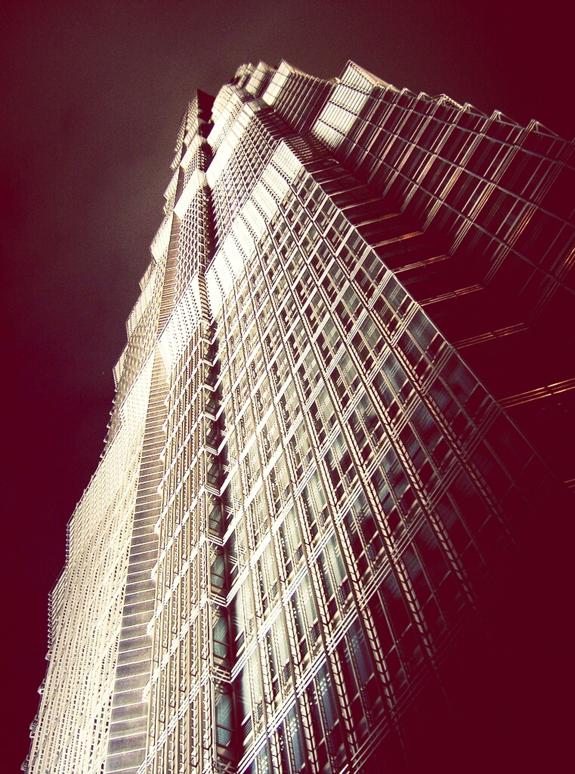 building exterior, architecture, built structure, low angle view, skyscraper, city, outdoors, no people, pattern, night, clear sky, modern, tall - high, development, building, winter, weather, sky, tall