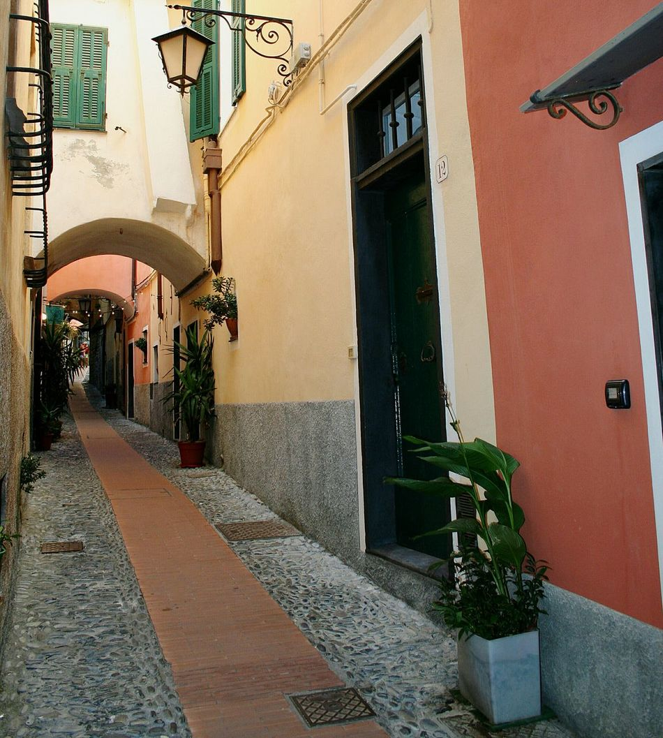 Architecture Building Exterior Built Structure No People Outdoors Day Mediterranean Village Old Street Narrow Street Vicolo Del Paese Travel Destinations Italian Village  Architectural Details Old Buildings Liguria,Italy Arch Tunnel The Way Forward Blooming In The Street Architectural Detail