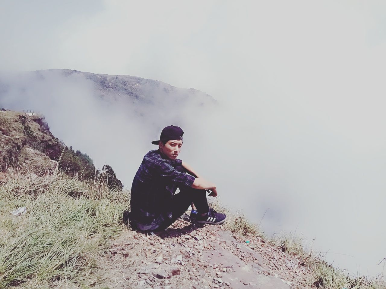 real people, mountain, sitting, one person, nature, leisure activity, full length, backpack, beauty in nature, hiking, outdoors, young adult, lifestyles, day, fog, adventure, scenics, tranquility, young women, landscape, sky, people