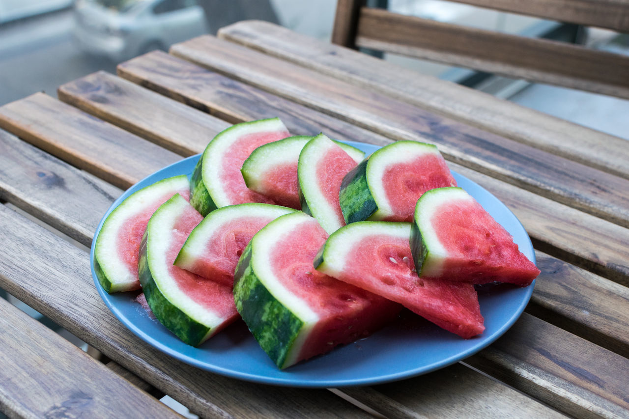 summer melons Close-up Day Flavored Ice Food Food And Drink Fresh Fruits Freshness Fruit Fruits Healthy Eating Melon No People Outdoors Plate SLICE Summer Table Watermelon Wood - Material