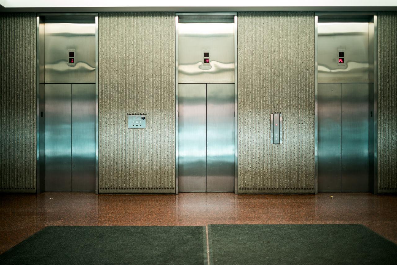Closed Day Door Elevator Indoors  Locker Room Metal Modern No People Office Protection Safety Shiny Sliding Door