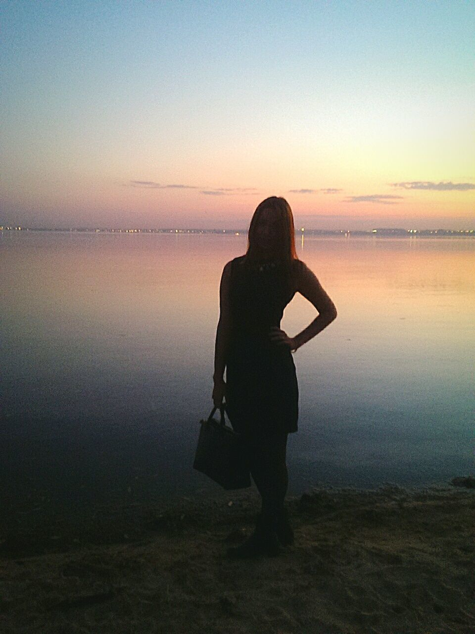 sunset, water, sea, sky, beach, nature, silhouette, horizon over water, full length, beauty in nature, scenics, one person, tranquility, reflection, clear sky, real people, outdoors, women, young adult, day, people